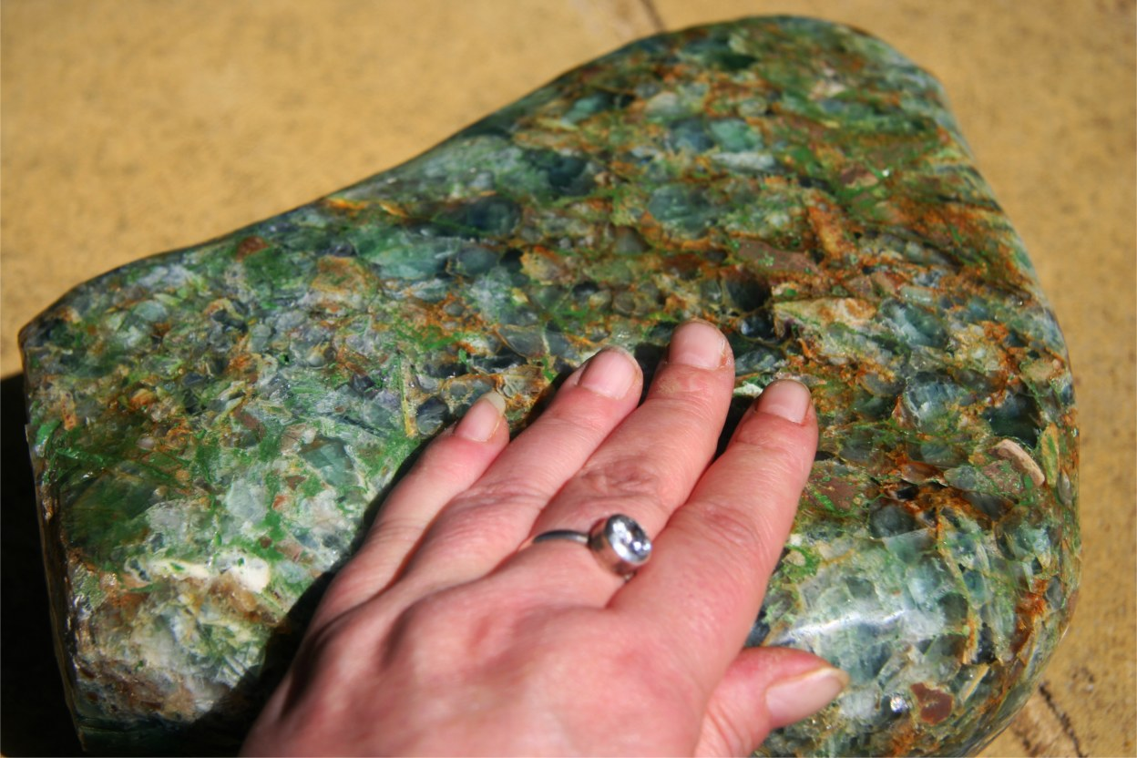 Mystery Stone with my hand to show the size